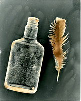 Bottle and Feather